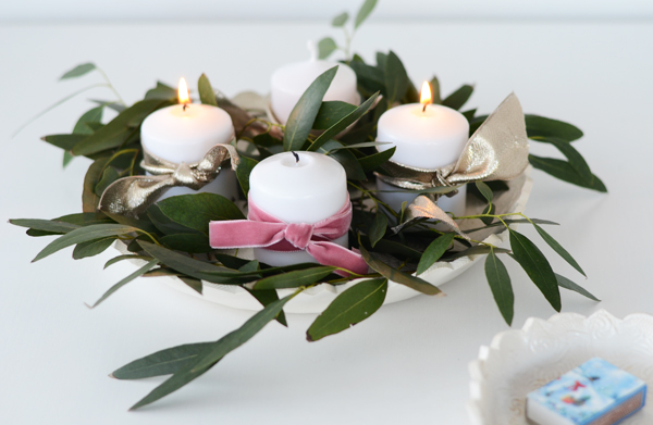 Make your own advent wreath with candles, ribbon and eucalyptus