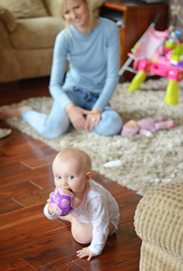 Put the squishy ball around in her mouth so she could crawl